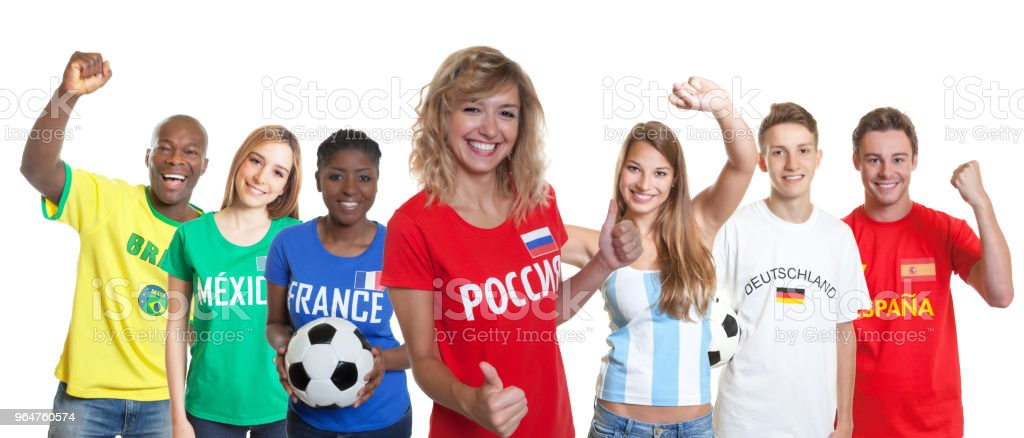 Happy russian soccer supporter with fans from other countries royalty-free stock photo