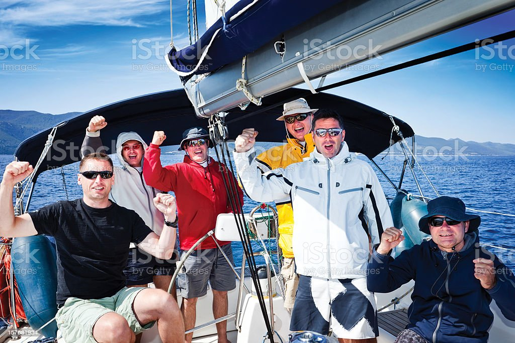 Happy sailing crew of 6 people royalty-free stock photo