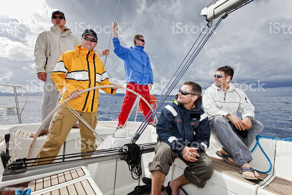 Happy sailing crew on sailboat royalty-free stock photo