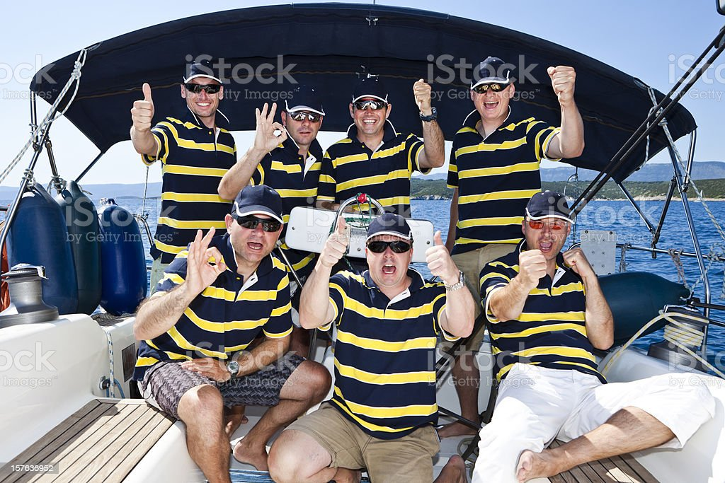 Happy sailing crew on sailboat royalty-free stock photo