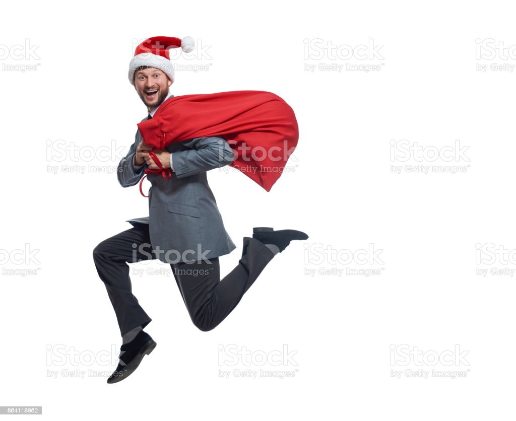 Happy santa clause jumping with bag of presents and gifts. royalty-free stock photo