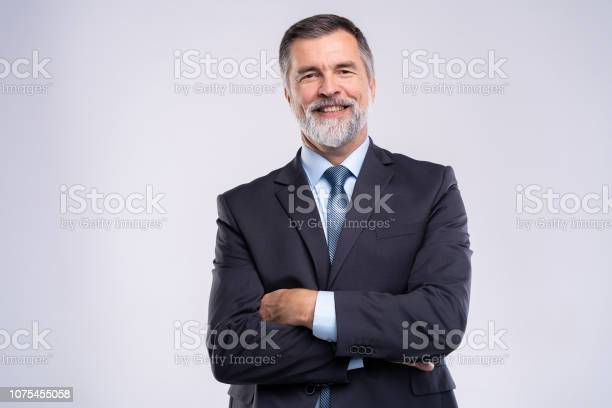 Happy satisfied mature businessman looking at camera isolated on picture id1075455058?b=1&k=6&m=1075455058&s=612x612&h= kzr5e0gopojc2zd2iub3 xzdo ld6y6vbxgdxmfnog=