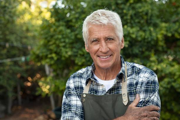 happy satisfied senior farmer - farmer foto e immagini stock