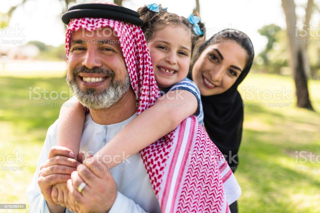happy saudi arabian family in the park stock photo