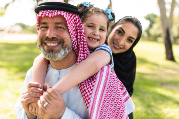 happy saudi arabian family in the park happy saudi family in the park saudi arabia stock pictures, royalty-free photos & images