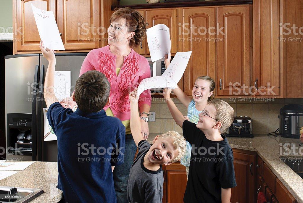 Happy school children showing high grades stock photo