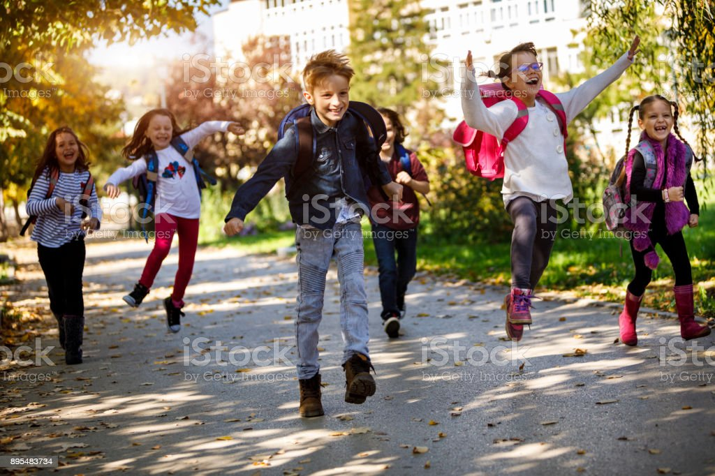 Happy school kids stock photo