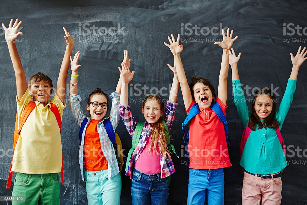 Happy schoolchildren stock photo