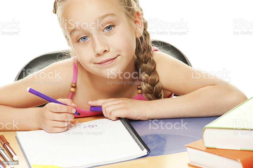 Happy schoolgirl drawing royalty-free stock photo