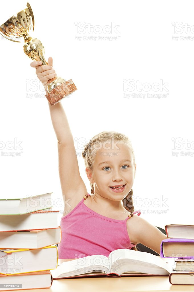 Happy schoolgirl with a golden cup royalty-free stock photo