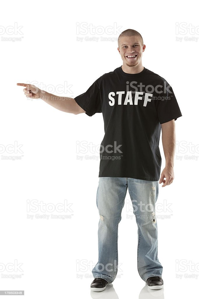 Happy security guard pointing royalty-free stock photo