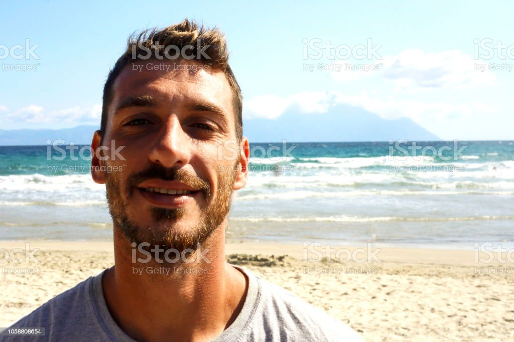 Happy selfie sea, beautiful young man near sea, smiling young man on the vacation stock photo