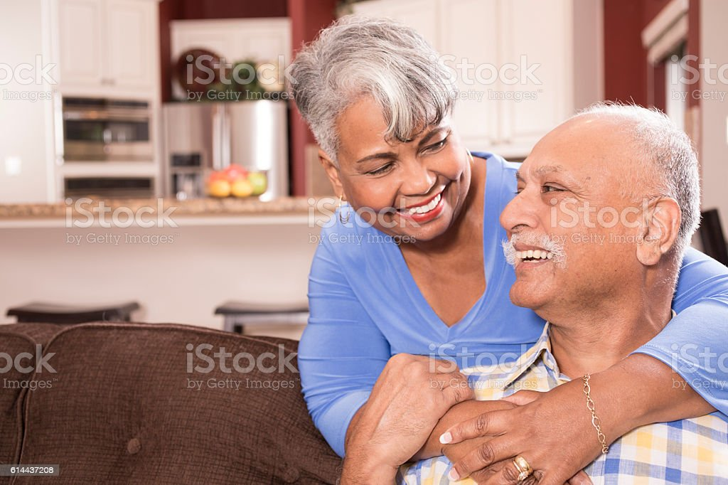 Happy senior adult couple at home. stock photo
