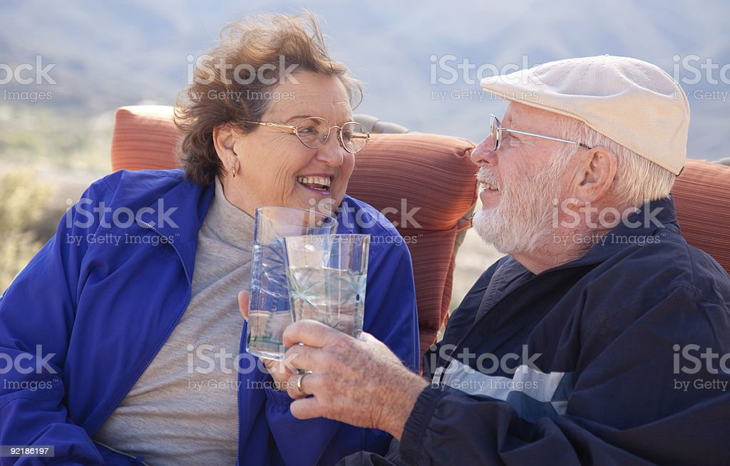 Happy Senior Adult Couple with Drinks royalty-free stock photo