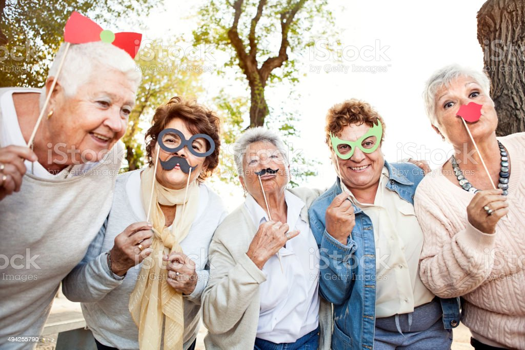 Happy senior adult women making faces stock photo