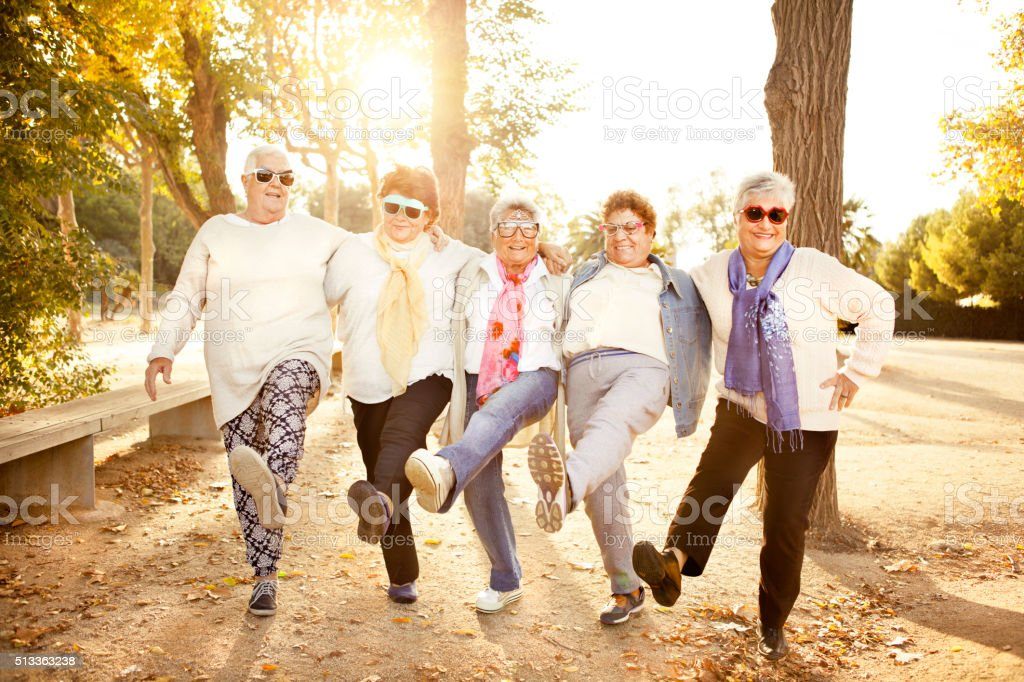 Happy senior adult women wearing sunglasses stock photo