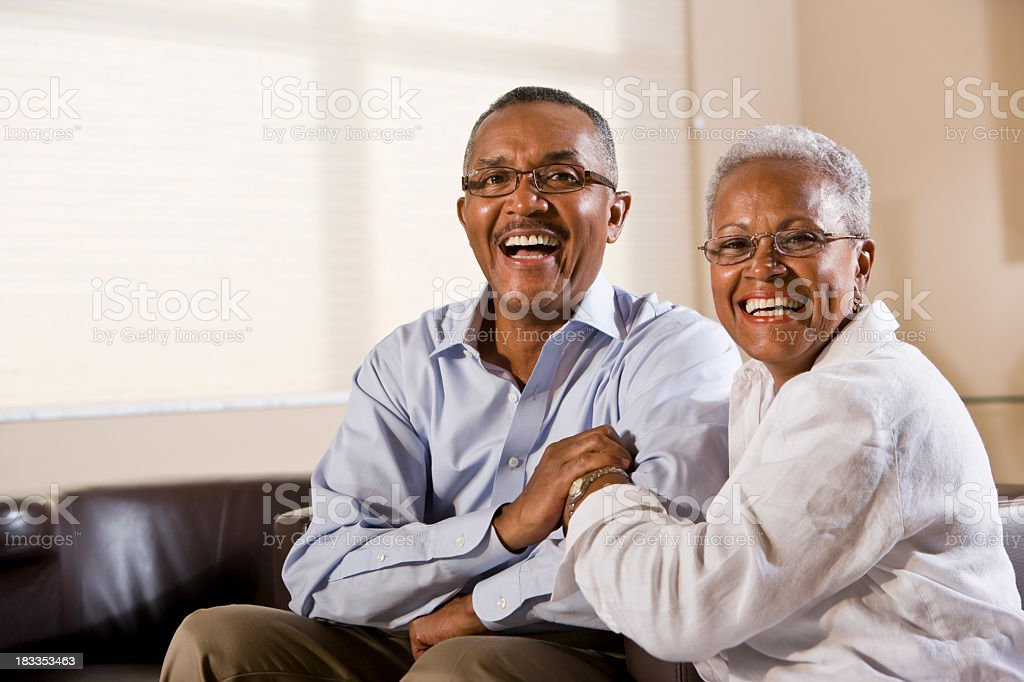 Happy senior African American couple wearing eyeglasses stock photo