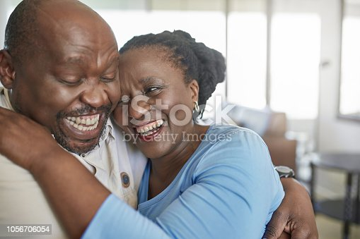 Happy senior African couple laughing and having a fun time.