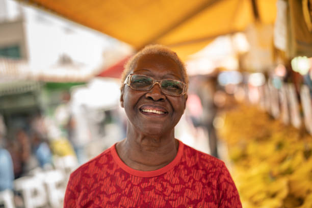 Happy Senior African Ethnicity Woman Portrait Looking at Camera real life stock pictures, royalty-free photos & images