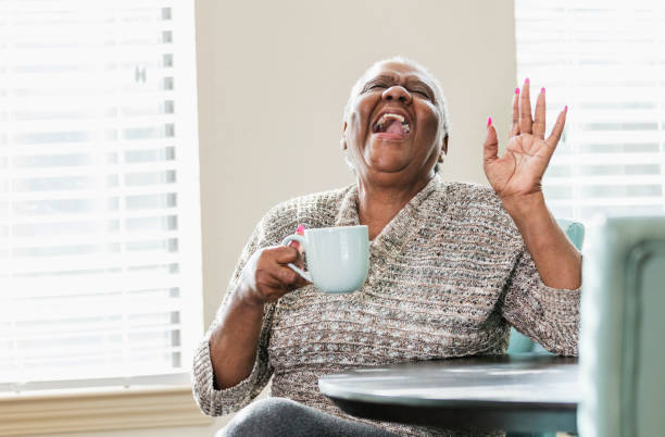happy senior african-american woman at home, coffee - funny fat lady stock photos and pictures