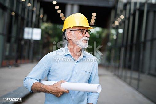 Happy senior architect.