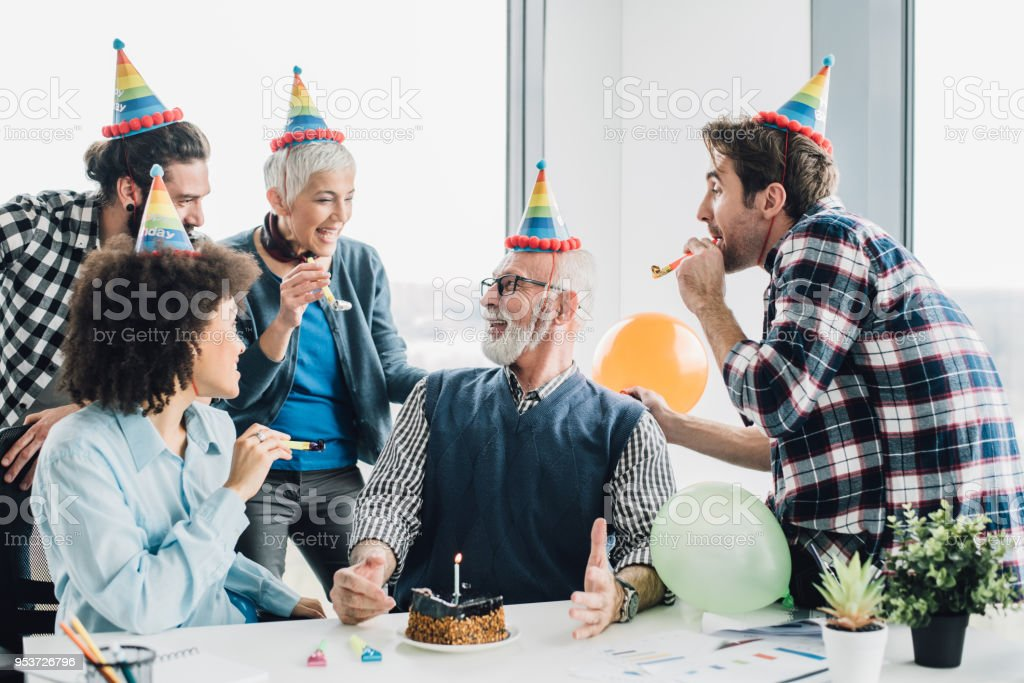 Coworkers celebrating birthday at office