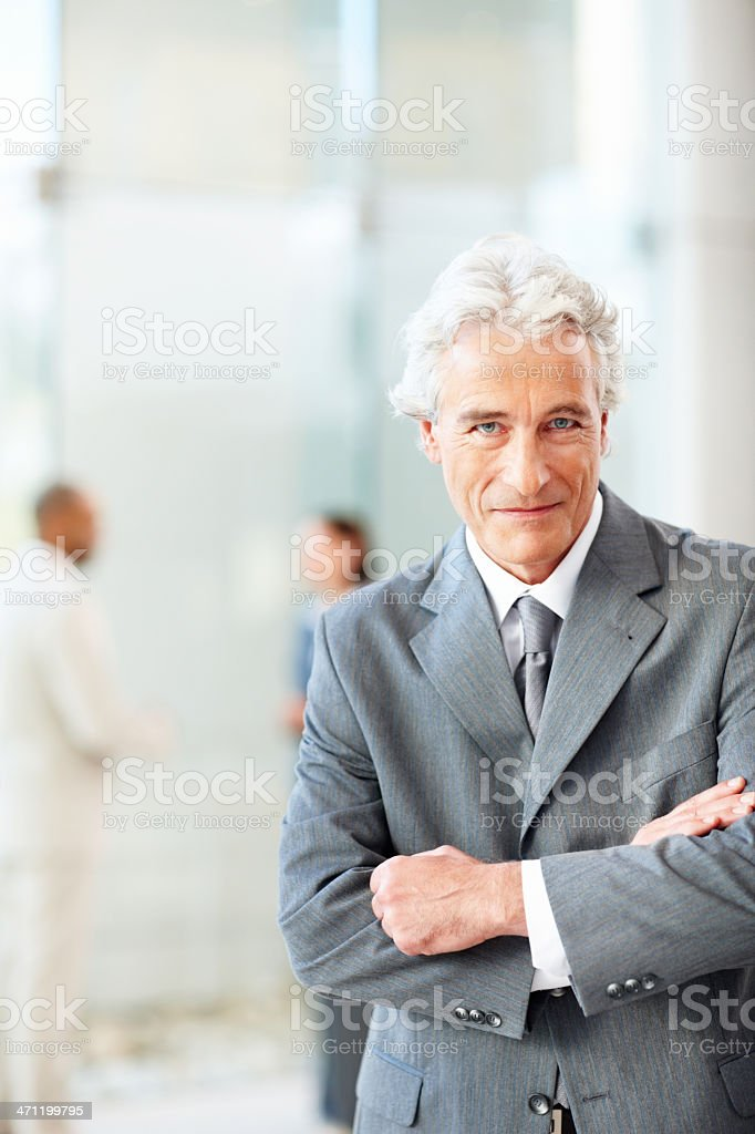 Happy senior businessman with his arms crossed royalty-free stock photo