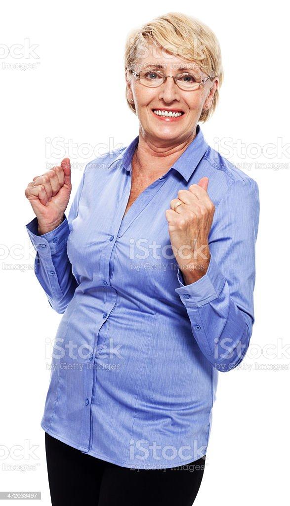 Happy senior businesswoman Portrait of happy senior businesswoman laughing at camera. Studio shot, white background. 60-69 Years Stock Photo