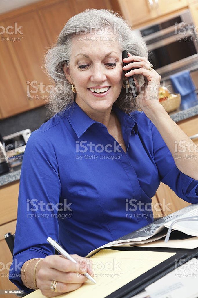 Happy senior businesswoman working at home royalty-free stock photo