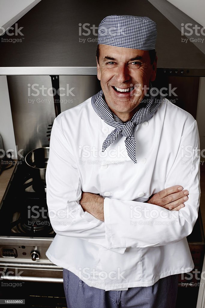 Happy senior chef with hands folded stock photo