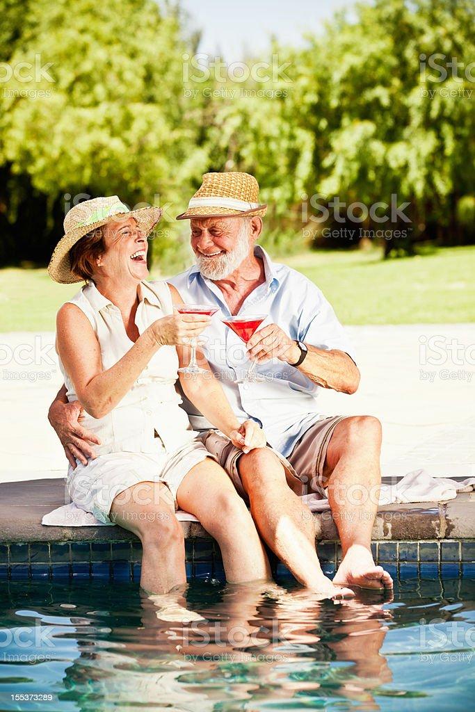 Happy Senior Couple at the Swimming Pool royalty-free stock photo