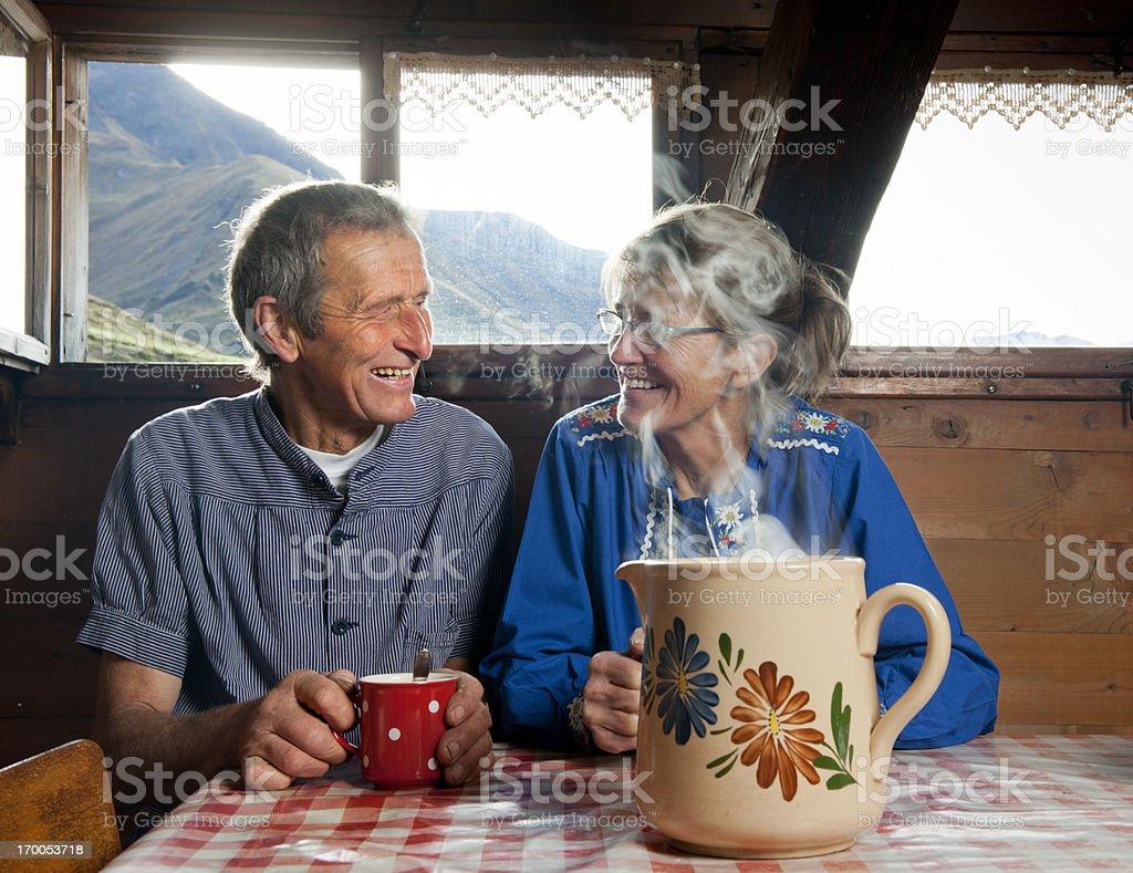 happy senior couple drinking coffee in farmhouse stock photo