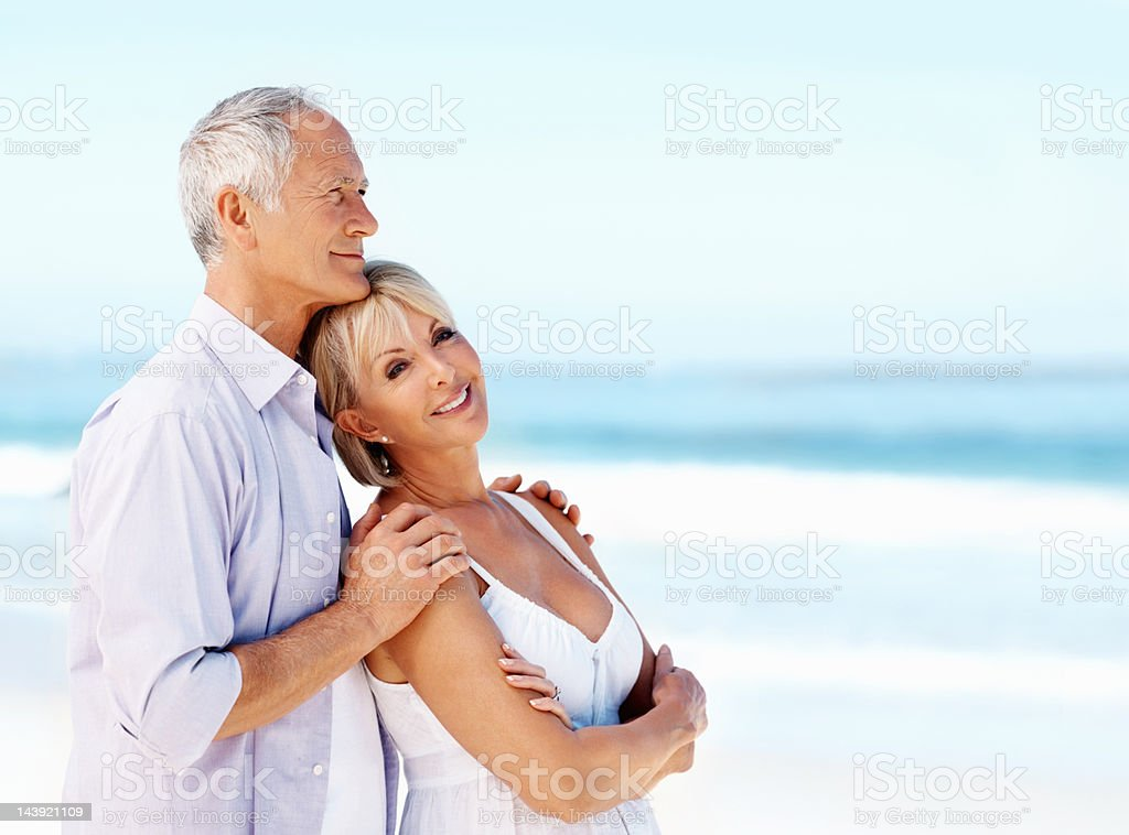 Happy senior couple enjoying the surrounding royalty-free stock photo