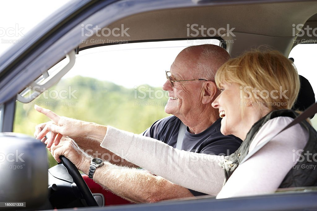 Happy senior couple going for a drive royalty-free stock photo