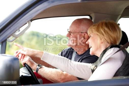 108329737istockphoto Happy senior couple going for a drive 185001333