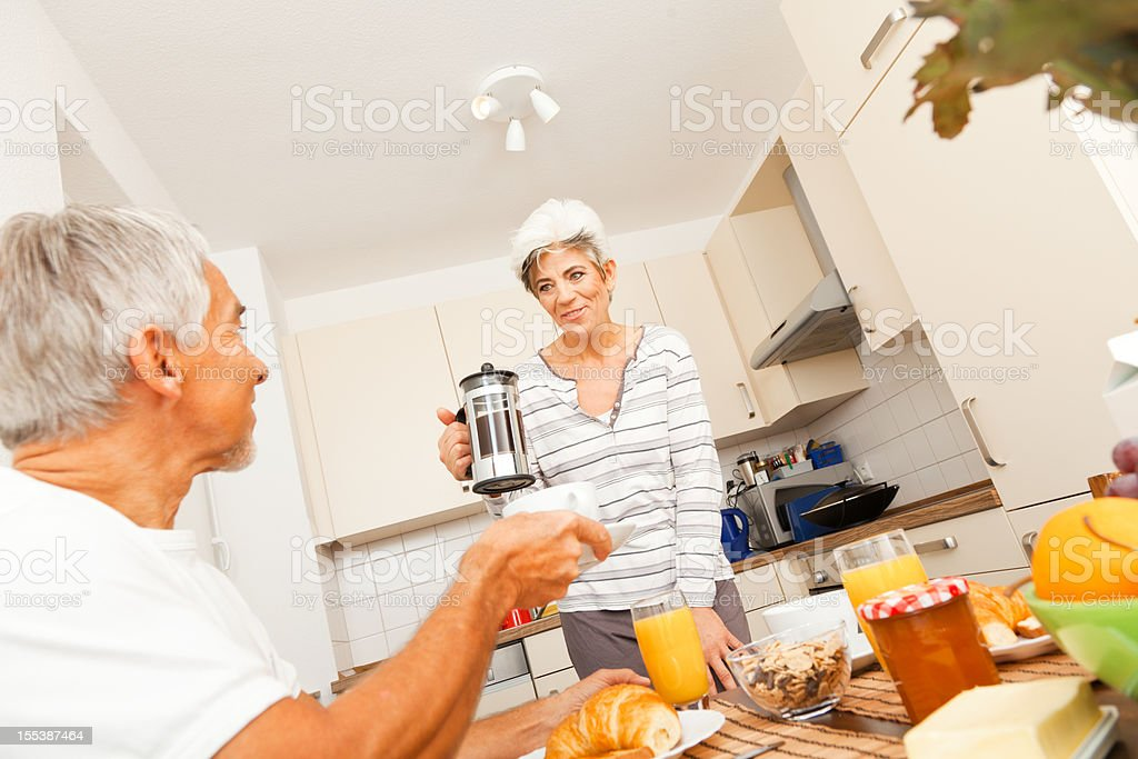 happy senior couple having breakfast royalty-free stock photo