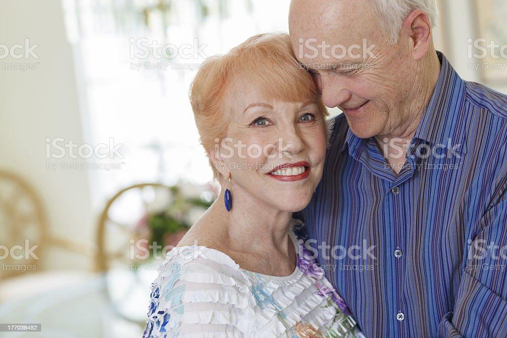 Happy Senior Couple in Diningroom stock photo