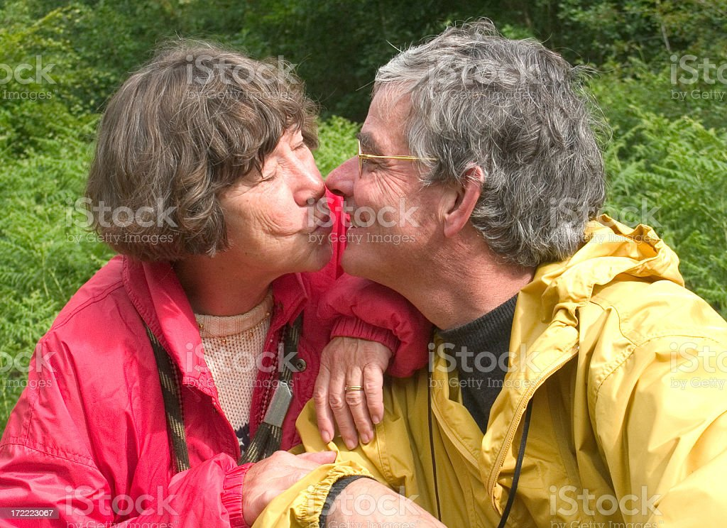 happy senior couple in love and kissing outdoors royalty-free stock photo