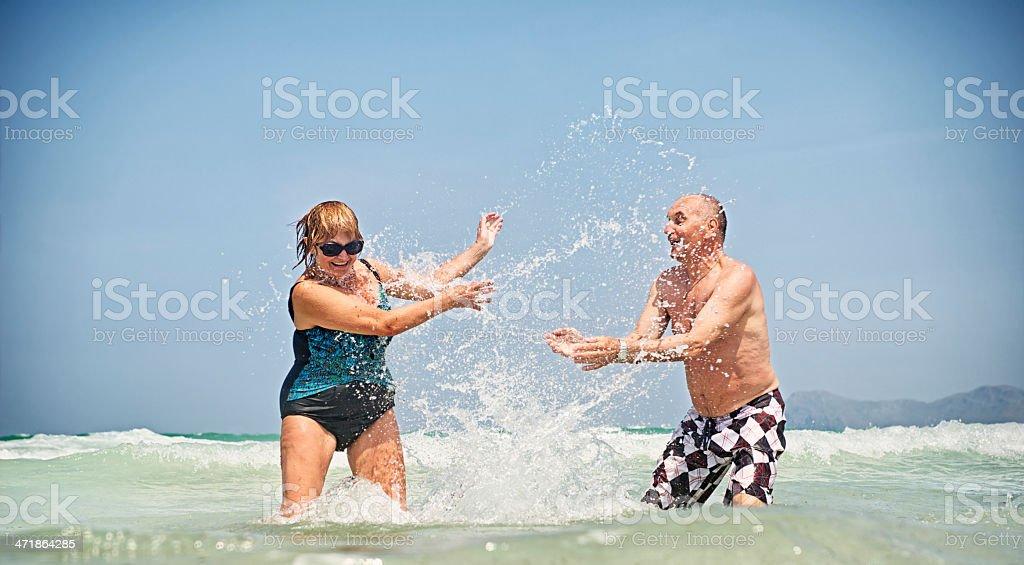 Happy senior couple in sea royalty-free stock photo