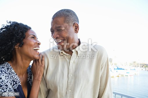 Happy senior couple laughing while taking walk together