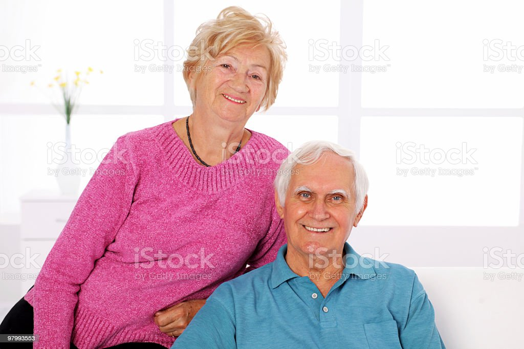 Happy senior couple looking at camera. royalty free stockfoto