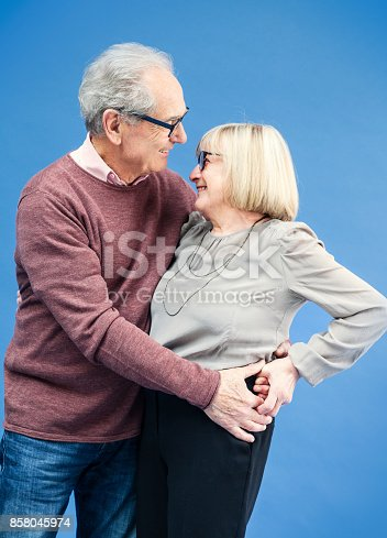 518911782istockphoto Happy senior couple looking at each other, embracing 858045974