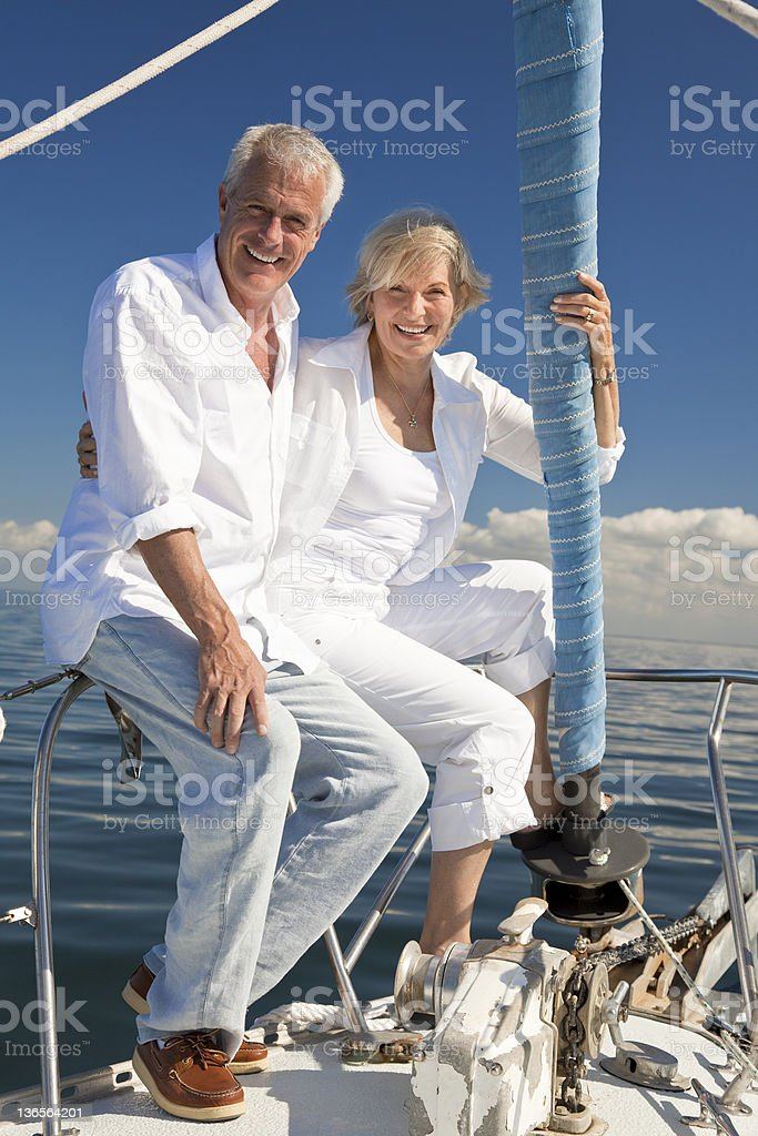 Happy Senior Couple on a Sail Boat royalty-free stock photo