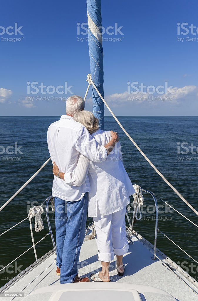 Happy Senior Couple On Front of a Sail Boat royalty-free stock photo