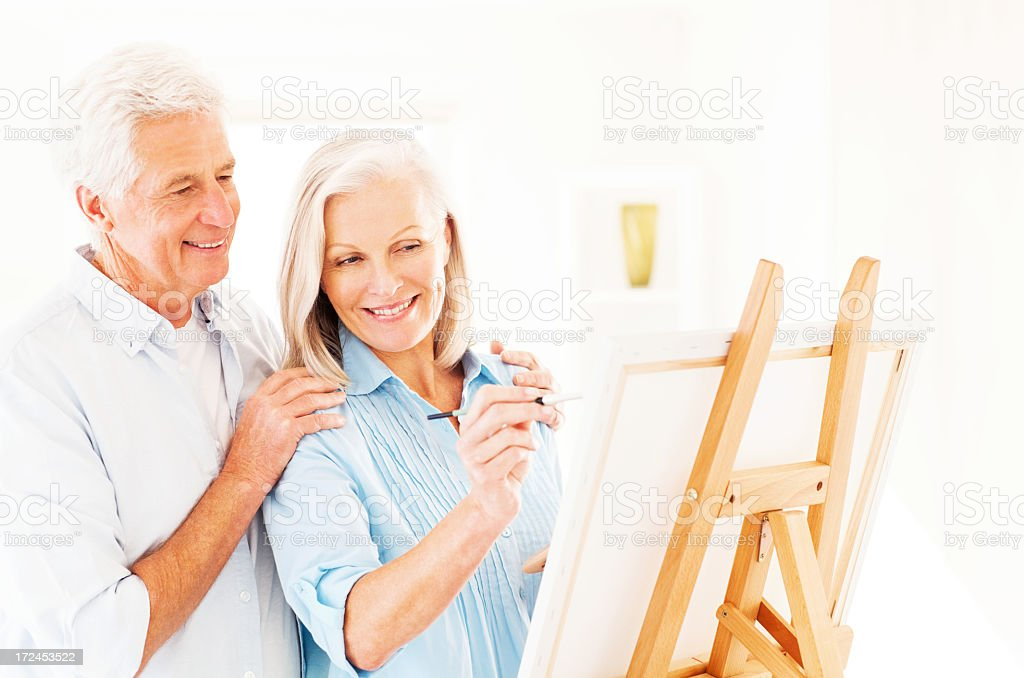 Happy Senior Couple Painting On Canvas royalty-free stock photo
