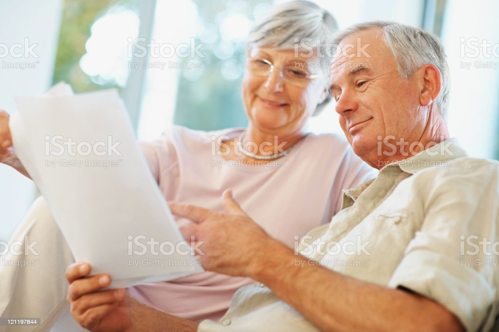 Happy senior couple planning for retirement royalty-free stock photo