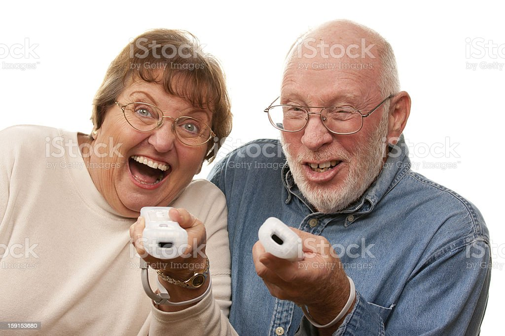 Happy Senior Couple Play Video Game with Remotes stock photo