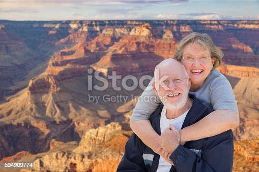 istock Happy Senior Couple Posing on Edge of The Grand Canyon 594909774