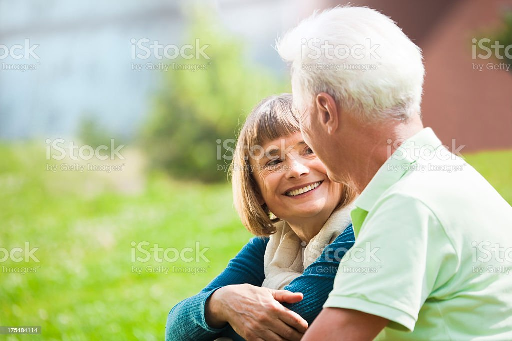 Happy senior couple resting in a park (Berlin, Germany) royalty-free stock photo
