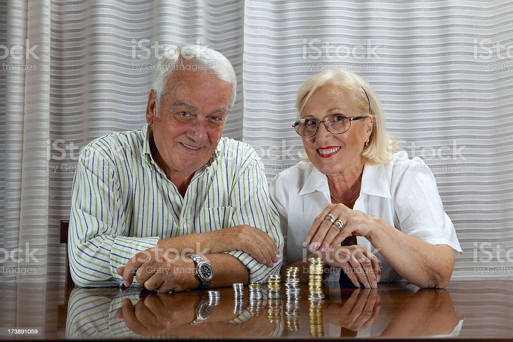 Happy senior couple savings royalty-free stock photo